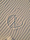 Peace sign on the sand. View at the sign on the sand in a desert Stock Photo