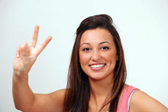 Peace sign smiling female Stock Image