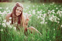 Peace sign from smiling free hippie royalty free stock image