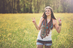 Peace sign from smiling hippie Stock Photo