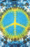 Peace sign tie dyed pattern on cotton fabric for background. Stock Images