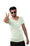 Peace sign by trendy male Royalty Free Stock Photography