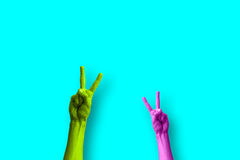 Peace sign. Two hands doing the peace and love sign in a colorful pop art style Stock Photos