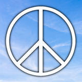 Peace sign. Universal Peace sign over a sunny blue sky, originally adopted as a nuclear disarmament and anti-war icon in the sixties it now embodies peace and Royalty Free Stock Photos