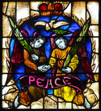 Peace Stained Glass. A single picture representing peace created from multiple glass pieces leaded into position representing the peace that can be achieved in royalty free stock photos