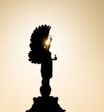 Peace Statue Hove. Peace Statue on the seafront boundary between Brighton and Hove, backlit by sun Royalty Free Stock Photo
