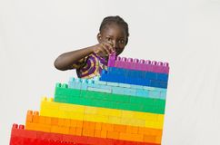 Peace symbol - African girl building blocks for a future without. Beautiful shot of African children taken in a studio in Bamako, Mali Stock Images