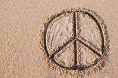 Peace symbol drawn at the beach stock photography