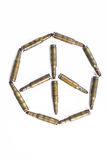 Peace symbol formed by old bullets, abstract concept Royalty Free Stock Photo