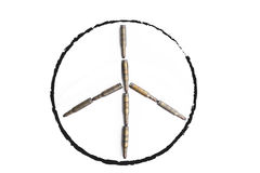 Peace symbol formed by old bullets, abstract concept Stock Image