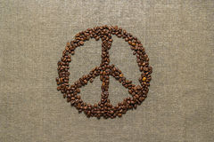 Peace symbol made from coffee beans Stock Image