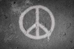 Peace symbol spray painted on the wall royalty free stock photo