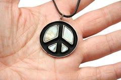 Peace symbols on hand Stock Photography