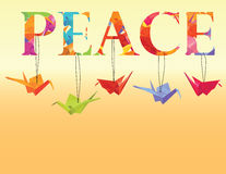 Peace text with colorful origami paper cranes Royalty Free Stock Photo