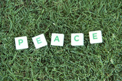 Peace Text On The Grass Stock Photo