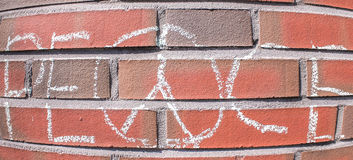 Peace. Text painted with chalk on a brick wall Royalty Free Stock Photography