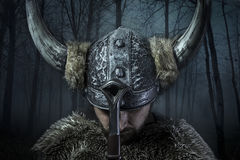 Peace, Viking warrior, male dressed in Barbarian style with swor Stock Photos