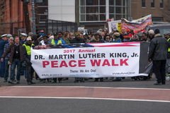 Peace Walk Commemorating Dr. Martin Luther King, Jr. Washington, DC - January 16, 2017: Marchers hold a banner for the Martin Luther King, Jr. Day Peace Walk stock photography
