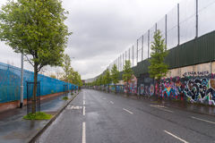 The Peace wall in West Belfast, Northern Ireland Stock Image