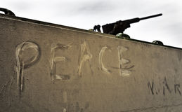 Peace and War. The word peace written on an old army tank royalty free stock images