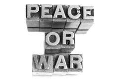 PEACE OR WAR sign, antique metal letter type Stock Image