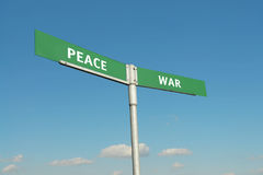 Peace and War signpost Royalty Free Stock Photos