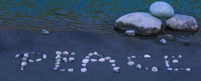Peace word made by pebbles. On the banks of river ganges in rishikesh Royalty Free Stock Photography