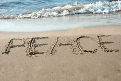 Peace written in the sand. On the beach royalty free stock photos