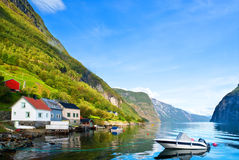 Peaceful boat on fjord in sunny day Royalty Free Stock Photo