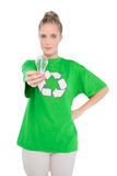 Peaceful activist wearing recycling tshirt holding light bulb Stock Photos