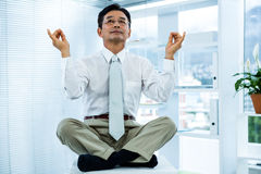 Peaceful asian businessman relaxing Stock Photography