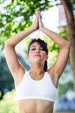 Peaceful athletic woman doing yoga with eyes closed Stock Image