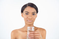 Peaceful attractive model holding glass of water Royalty Free Stock Image