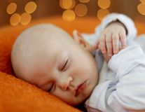 Peaceful baby lying on a bed Royalty Free Stock Images