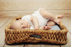 Peaceful baby lying on a bed Royalty Free Stock Photos