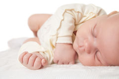 Peaceful baby lying on bed while sleeping Stock Photography