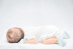 Peaceful baby lying on a bed while sleeping. Peaceful baby lying on a bed while sleeping in a bright room Stock Images