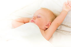 Peaceful Baby Lying On A Bed Sleeping Stock Images