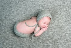 Peacful sleeping baby on her side. Peaceful baby sleeps on her side resting on her hands Royalty Free Stock Image