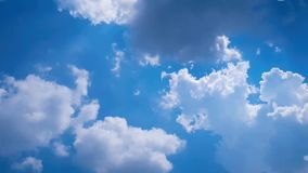 Time lapse sunbeam shine through the cloud on the blue sky . Sun rays. Peaceful background - beautiful blue sky with bright sun, light from heaven stock footage