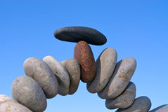 Peaceful and balanced. Stack of balanced stones by sea Stock Photo