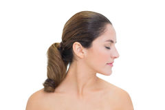 Peaceful bare brunette turning head right with closed eyes Stock Images