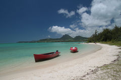 Peaceful beach. Two boats on a peaceful beach Mauritius Royalty Free Stock Images