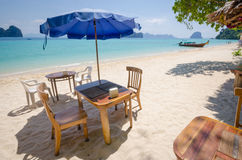 Peaceful beach. Chairs and Umbrella on the clear beach royalty free stock photos
