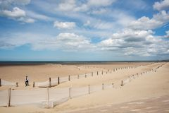 Peaceful beach of Dunkirk, in France. Place of the Dynamo operation in 1940. DUNKIRK, FRANCE – june 1, 2015 : It was on this peaceful beach that the Dynamo Stock Image