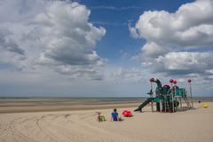 Peaceful beach of Dunkirk, in France. Place of the Dynamo operation in 1940. DUNKIRK, FRANCE – june 1, 2015 : It was on this peaceful beach that the Dynamo Royalty Free Stock Image