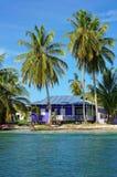 Peaceful beach house under coconut tree stock image