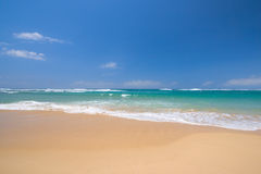 Peaceful beach scene. With ocean and blue sky Royalty Free Stock Photo