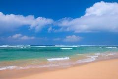 Peaceful beach scene. With ocean and blue sky Stock Photos