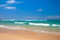 Peaceful beach scene. With ocean and blue sky Stock Image